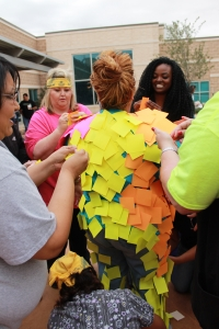 The yellow team wins the Post-it note challenge. They got 608 post its to stick to their team capital in 2 minutes.
